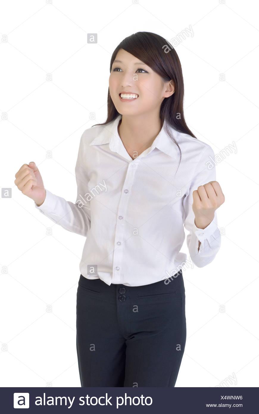 Business Woman avec excitation, closeup portrait of oriental office lady sur fond blanc. Photo Stock