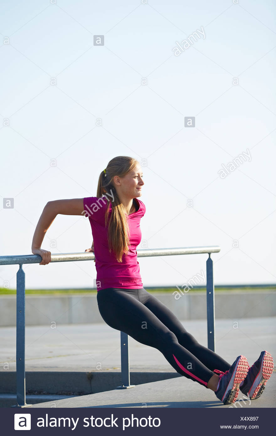 Runner stretching on rooftop Photo Stock