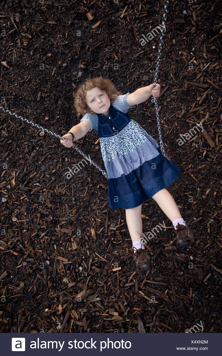 Girl (8-9) on swing Photo Stock