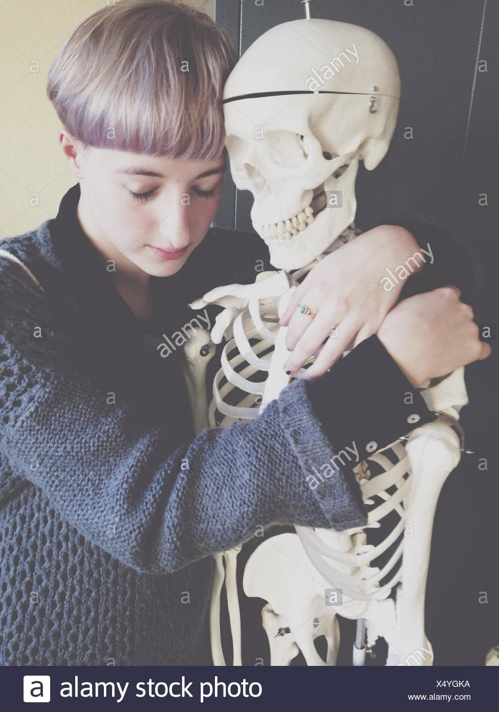 Sad Boy Hugging Skeleton Photo Stock