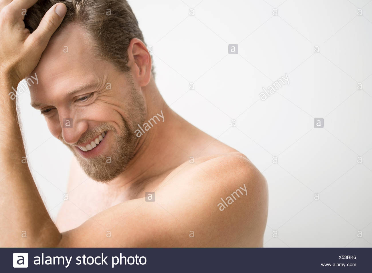 Smiling blonde man with bare chest Photo Stock