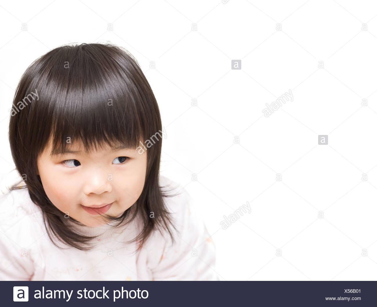 Sly Asian girl portrait avec drôle de visage. Banque D'Images