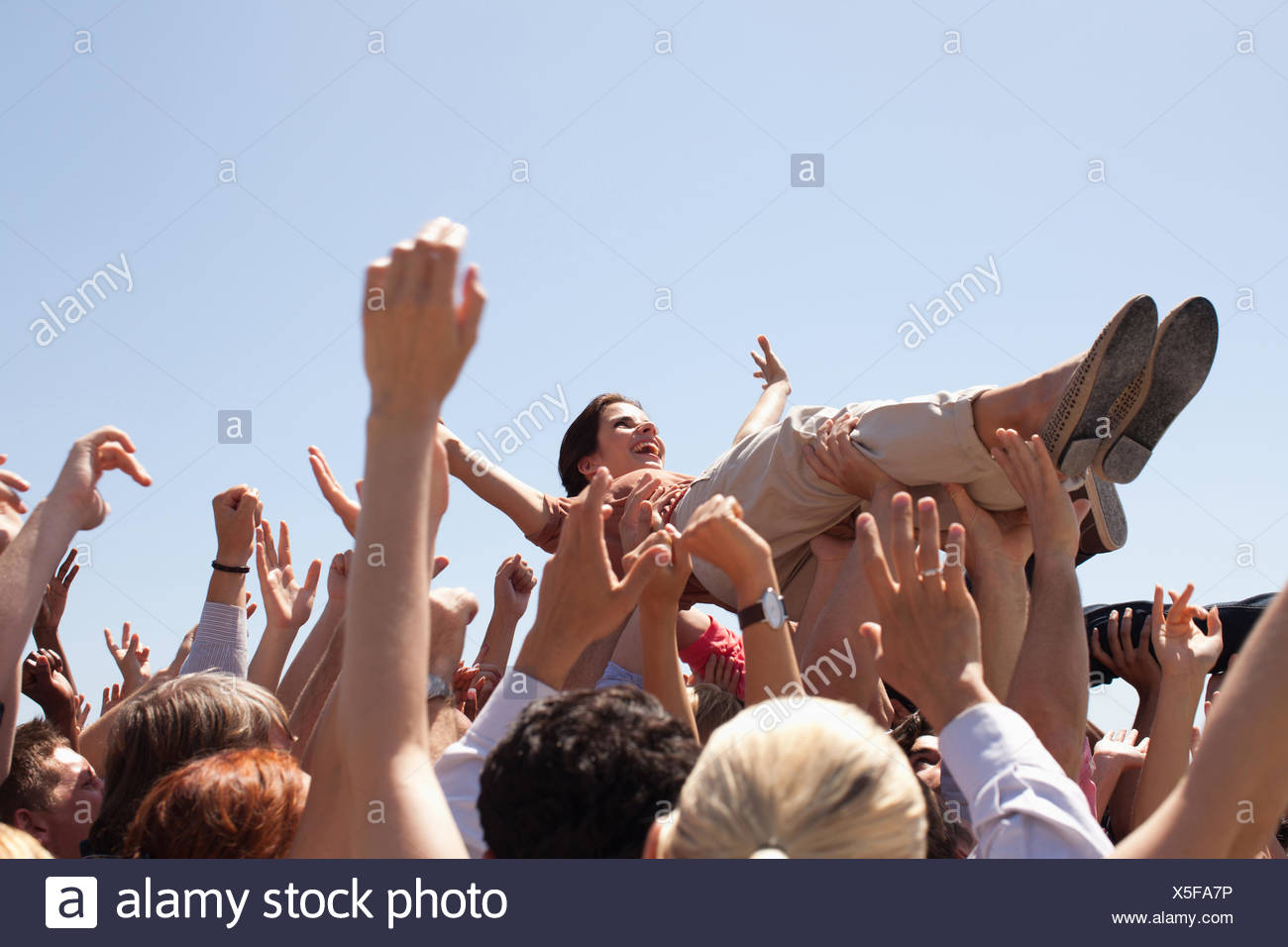 Woman crowd surfing Photo Stock