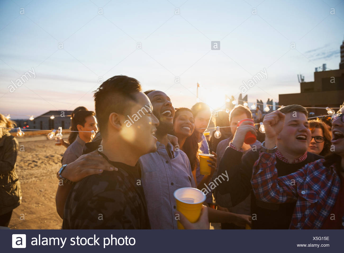 Friends enjoying urban rooftop party Photo Stock