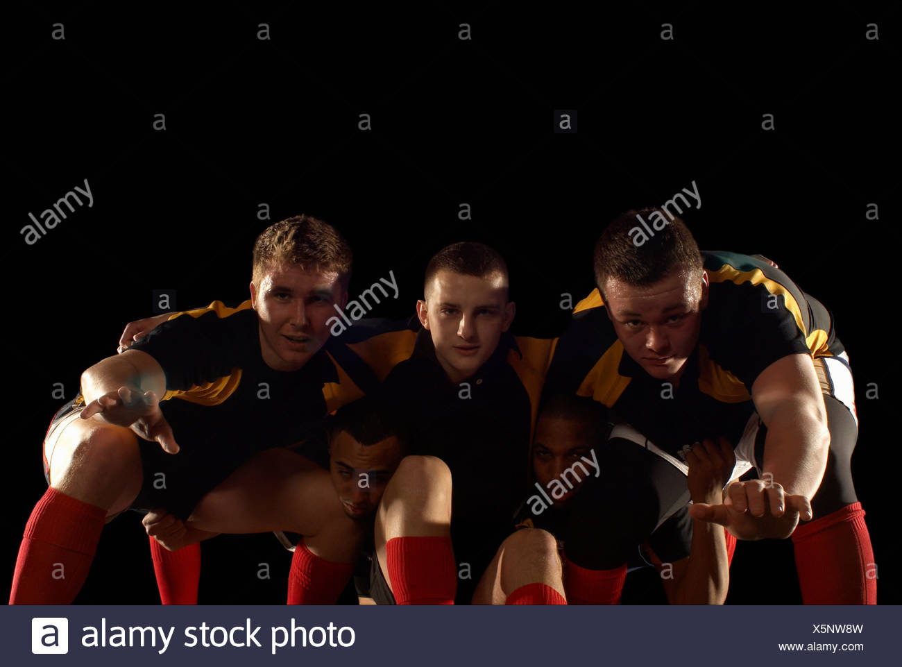 Joueurs de rugby de formation scrum Photo Stock