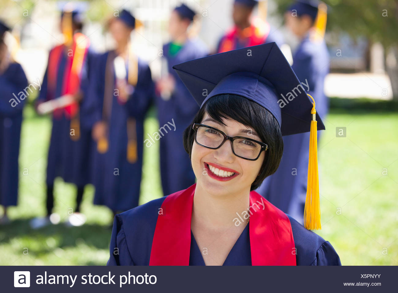 Graduate in cap and gown Photo Stock