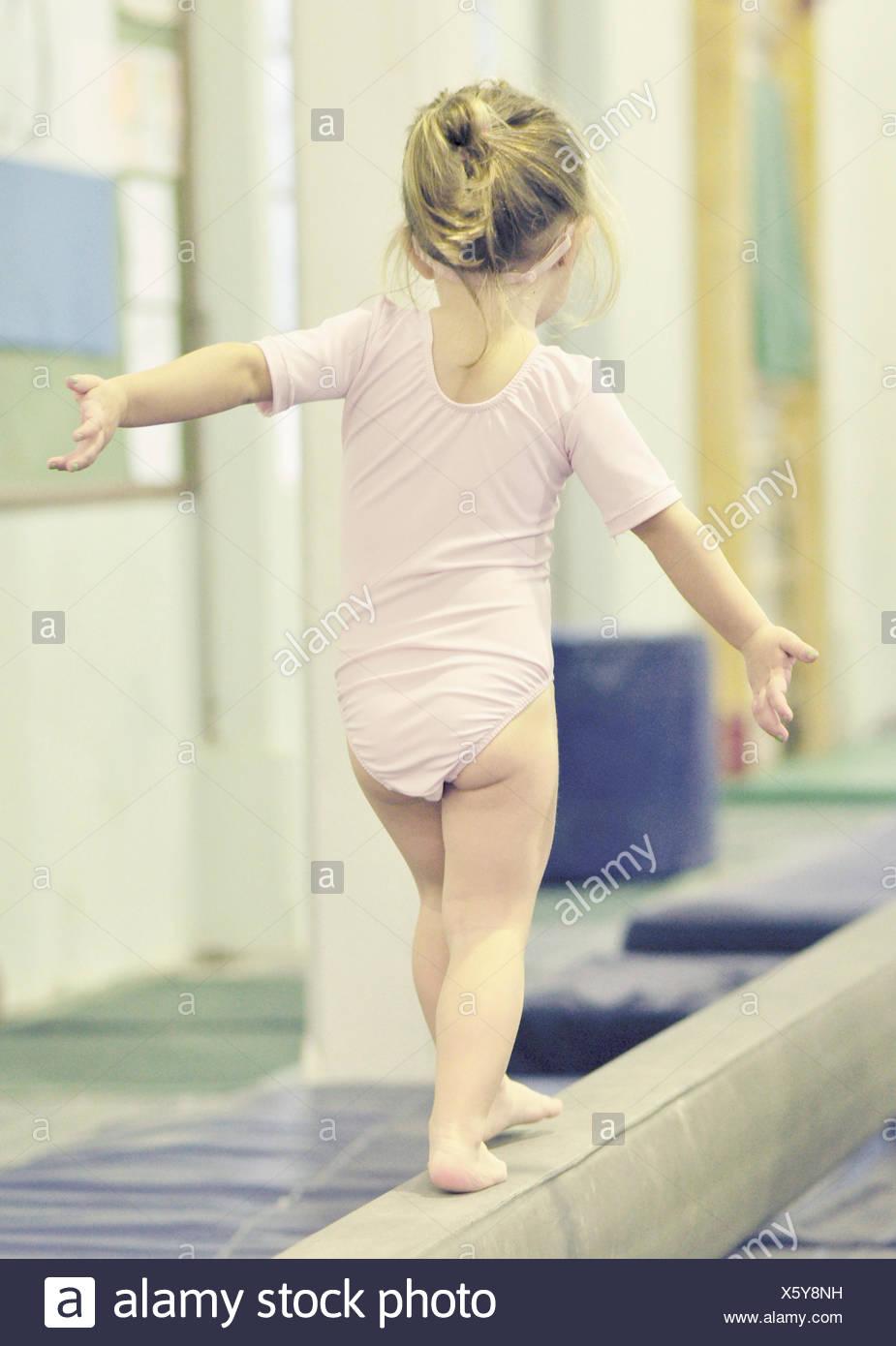 Girl (2-3) on balance bar Photo Stock