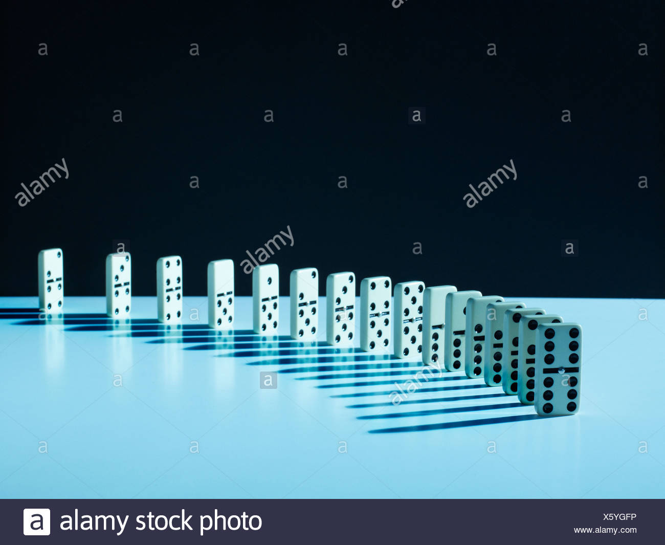 Dominos standing in a row Photo Stock