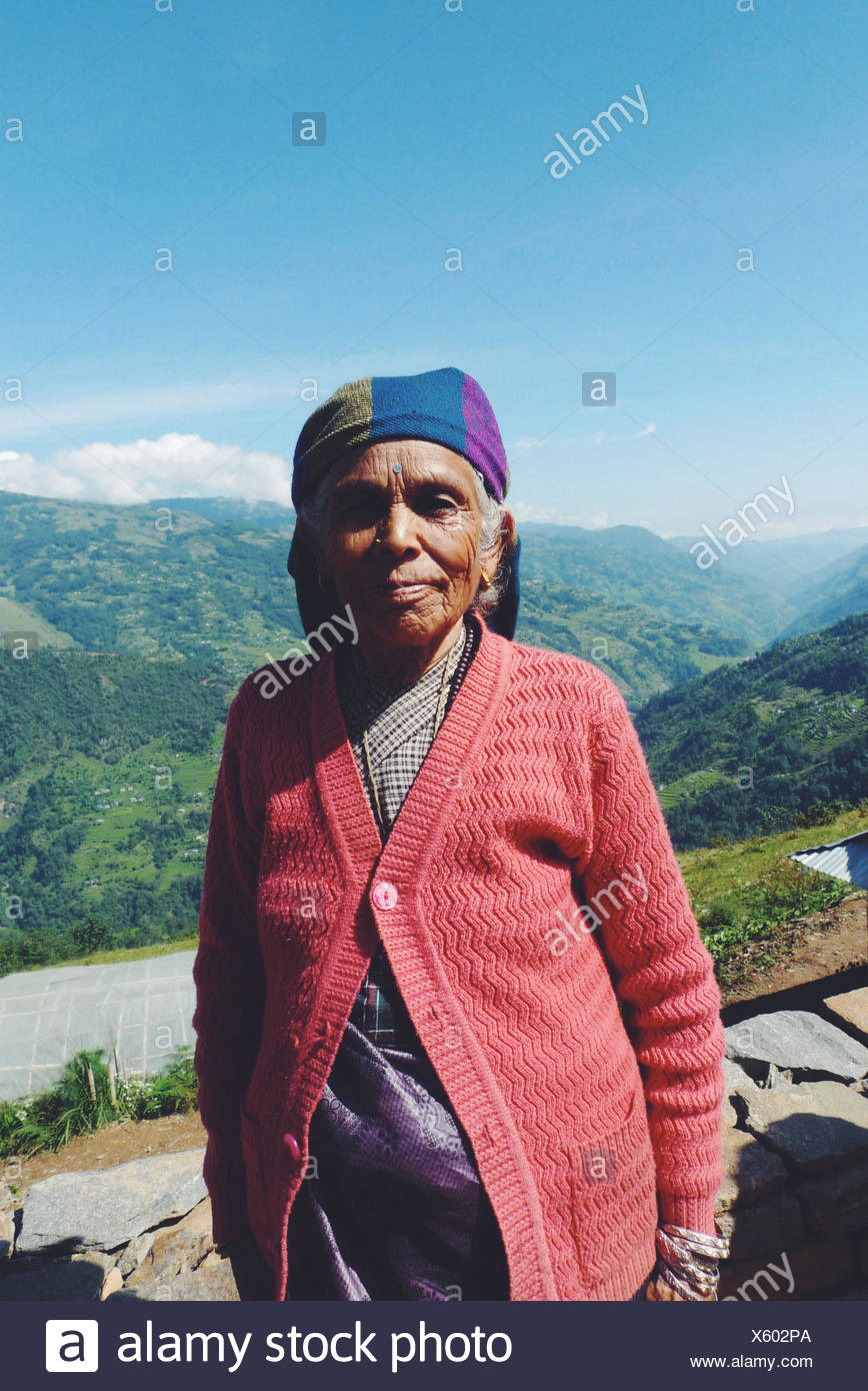 Portrait of woman standing in mountains Photo Stock