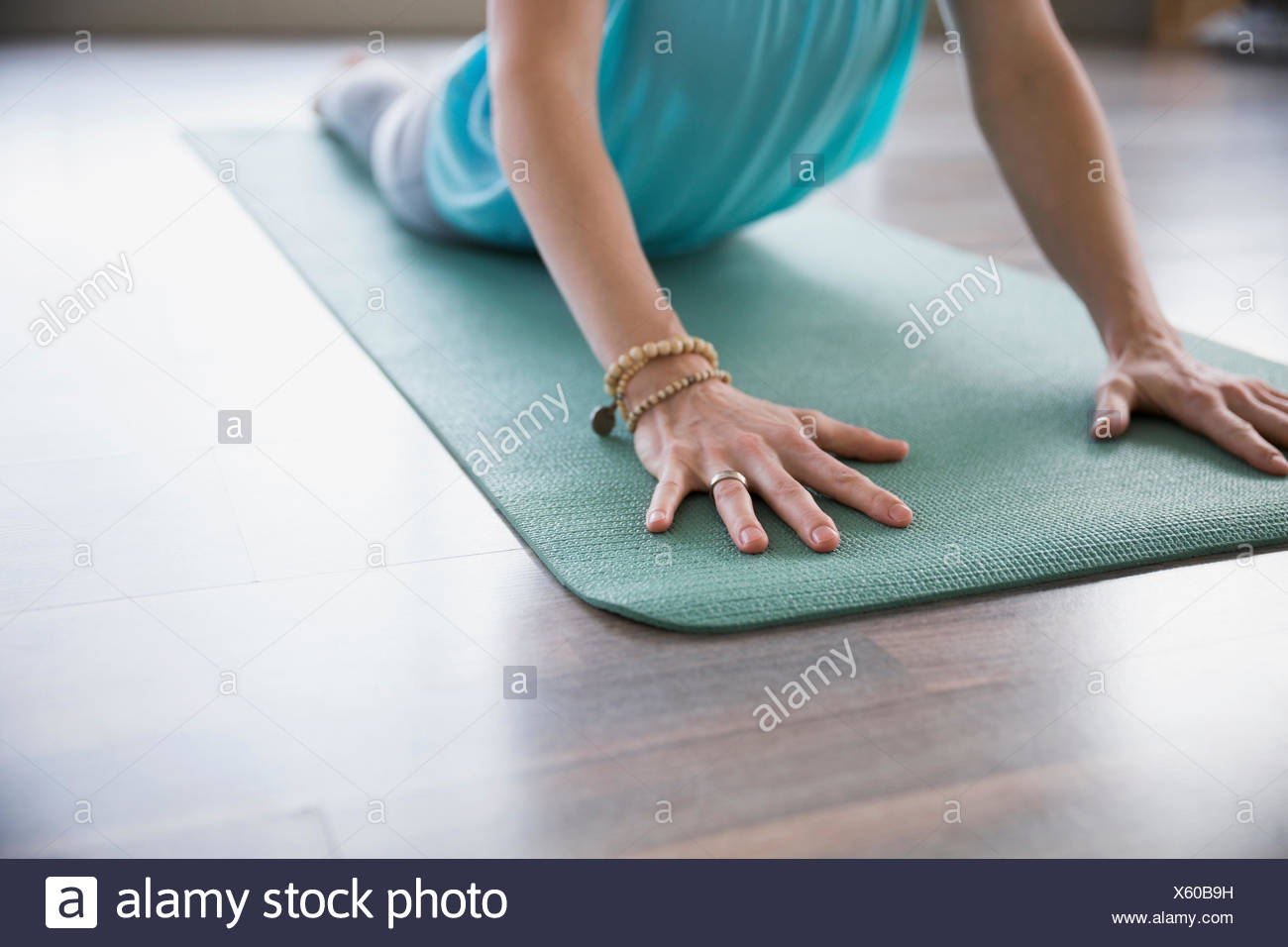 Woman practicing yoga in cobra posent Photo Stock