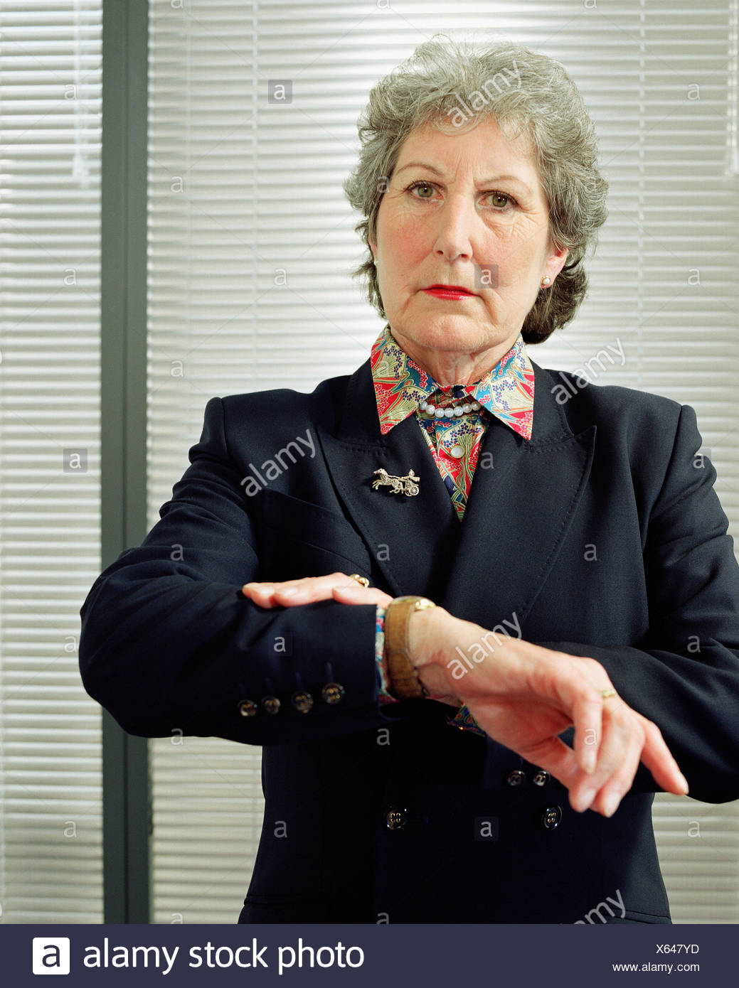 Businesswoman looking at watch Photo Stock