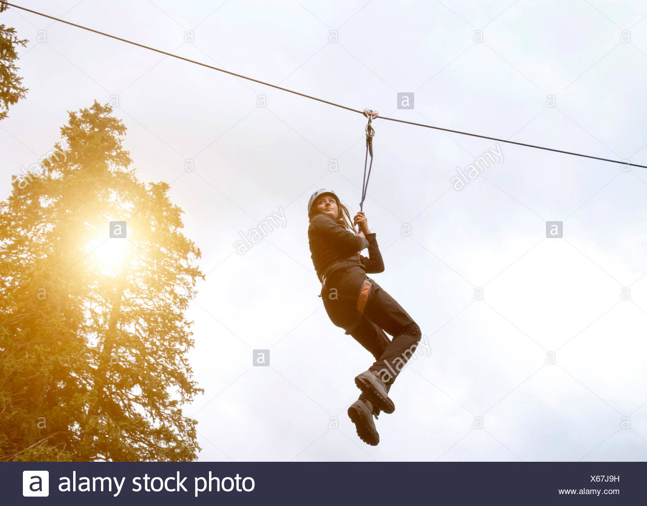 Teenage girl on zip wire Photo Stock