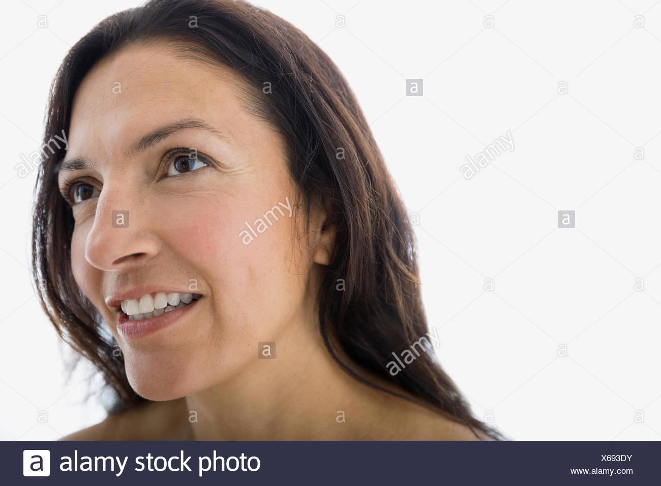 Close up portrait of smiling brunette woman Photo Stock