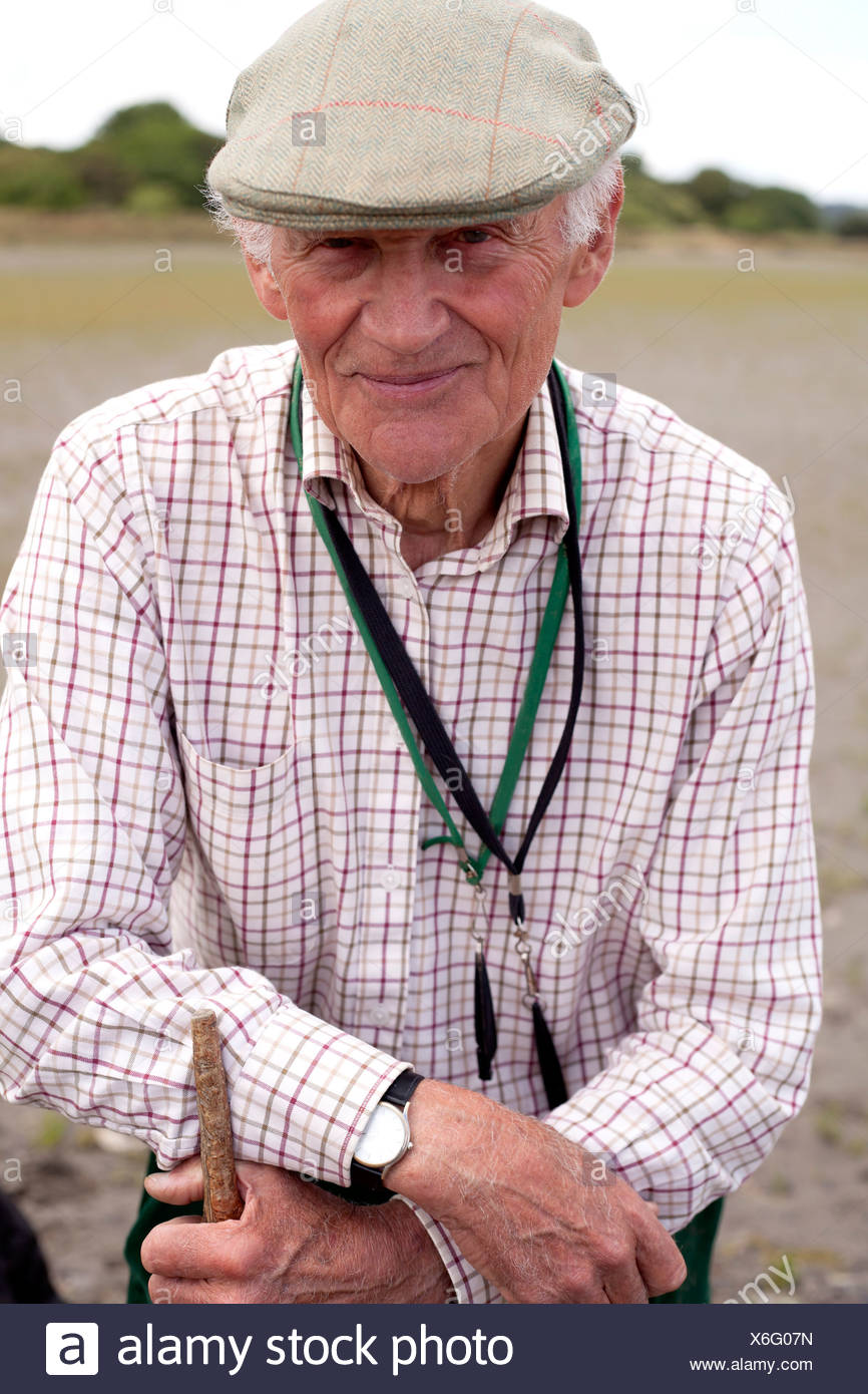 Portrait of senior man wearing flat cap Photo Stock