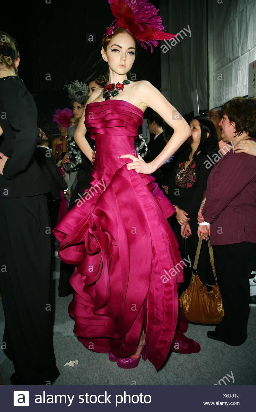 7576b98197b Dior Backstage Paris Automne Hiver Model wearing black satin rose robe  bustier à volants