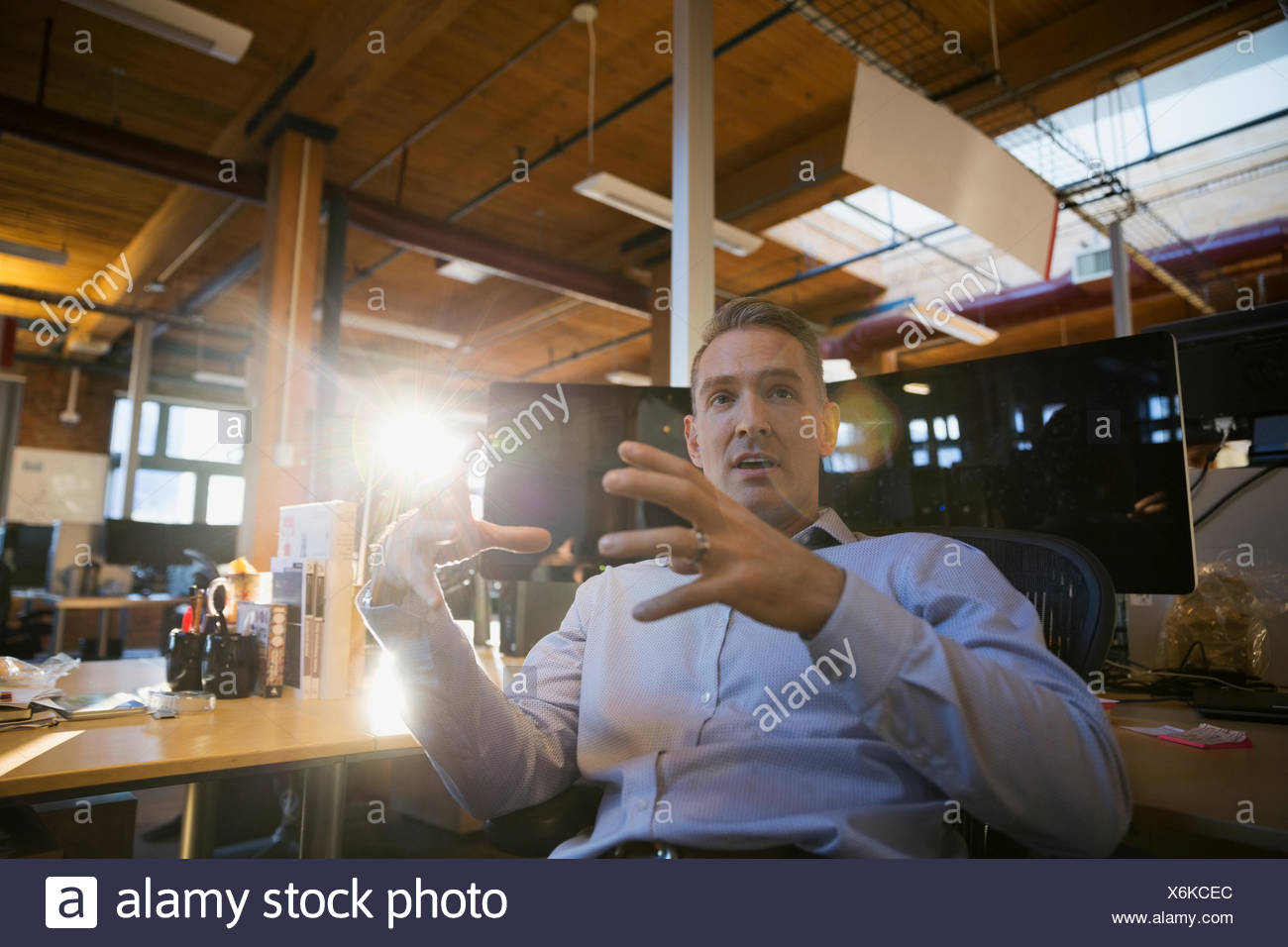 Businessman gesturing in office Photo Stock