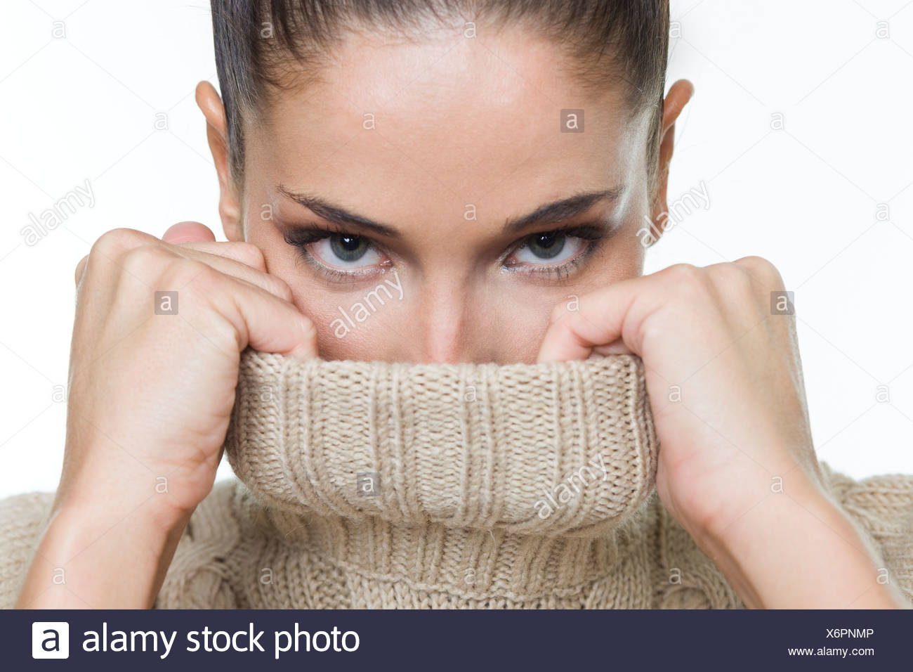 Young woman covering her face with sweater Photo Stock