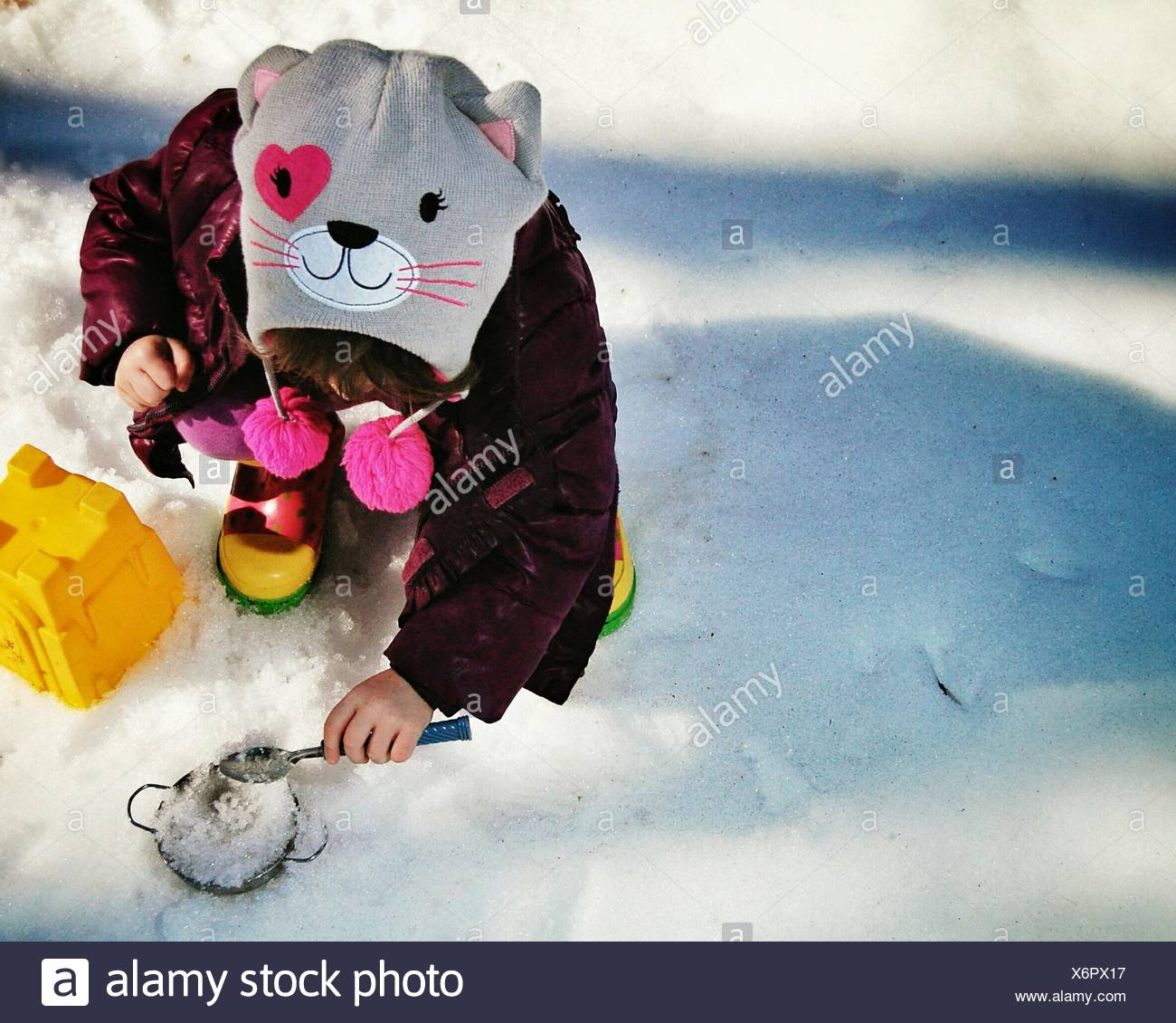 High Angle View of Little Girl Playing in snow Photo Stock