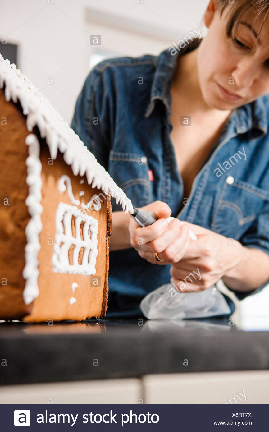 Woman making gingerbread house Photo Stock