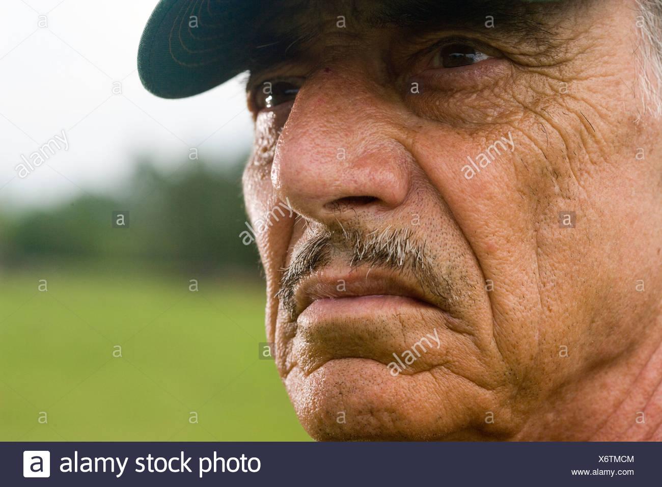 Close-up of smiling man wearing cap Photo Stock