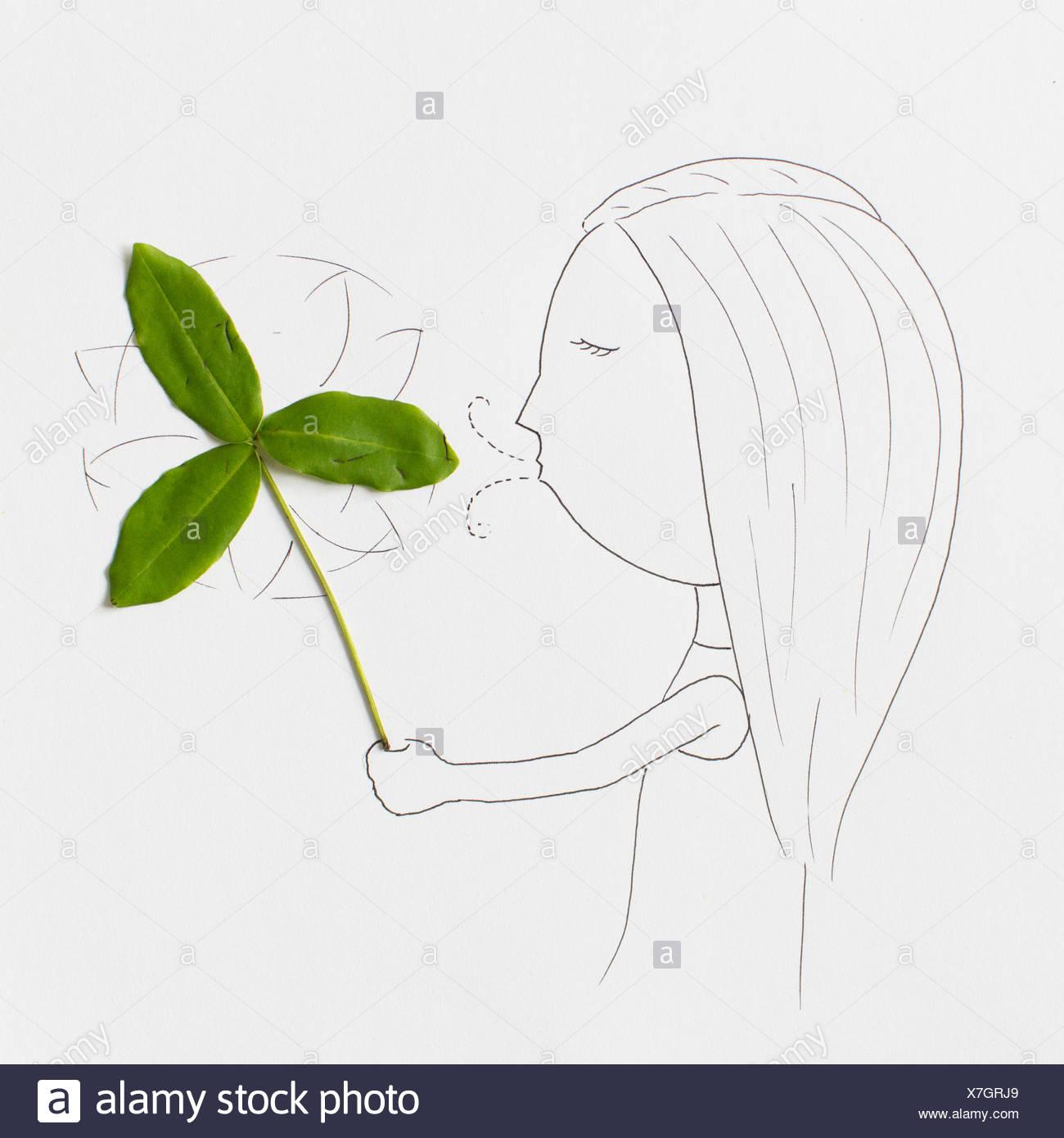 Conceptual girl blowing pinwheel une Photo Stock