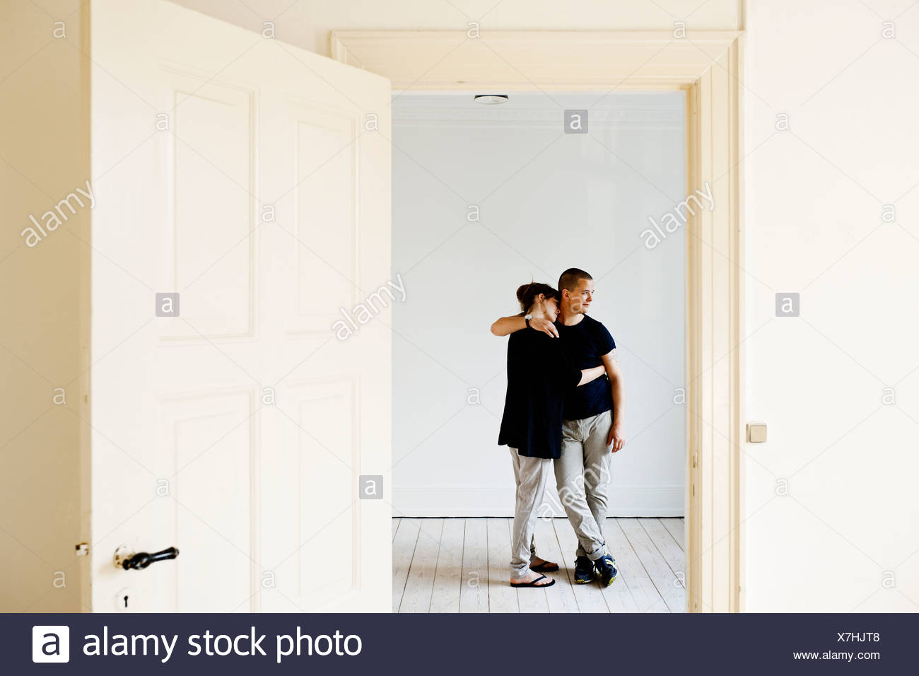 Couple hugging in new home Photo Stock