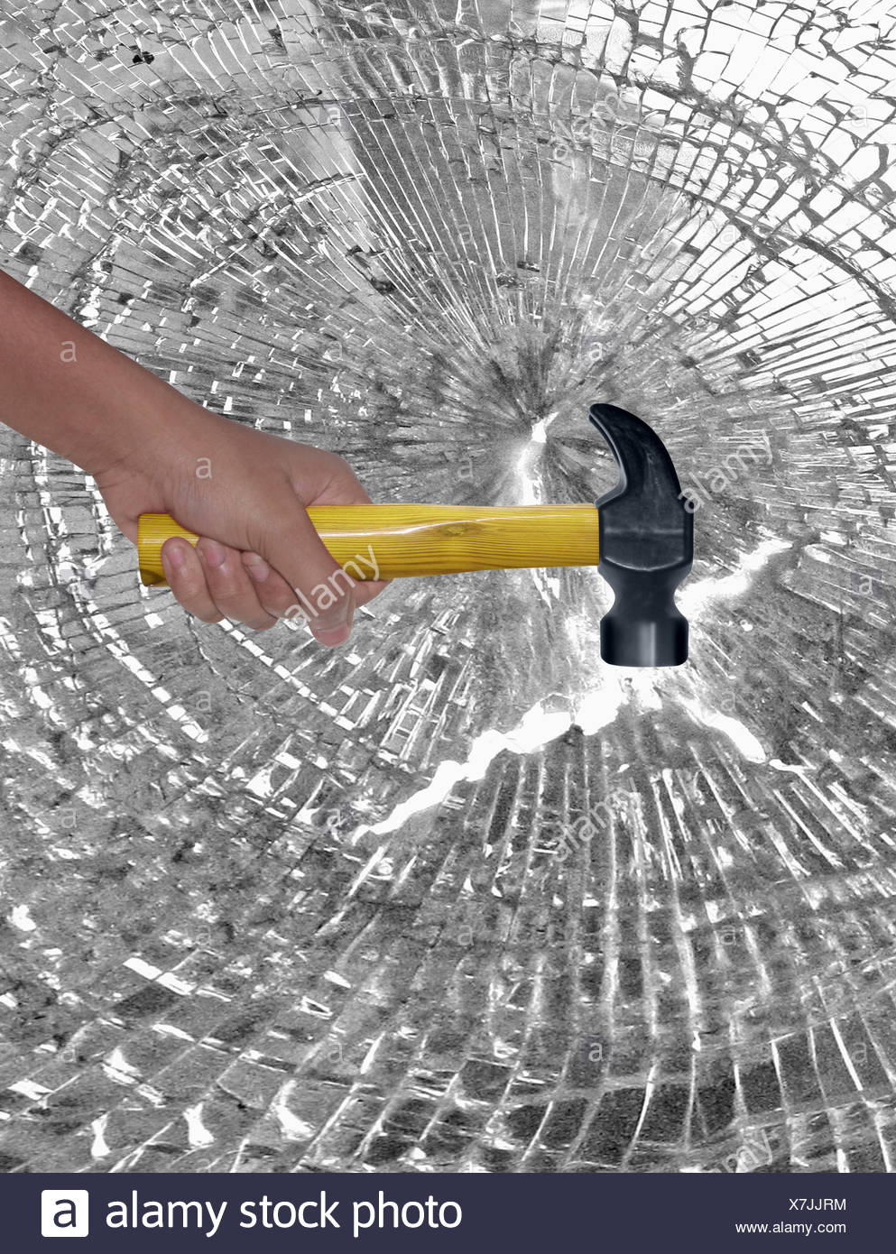 Le marteau à la main de verre frapper Banque D'Images