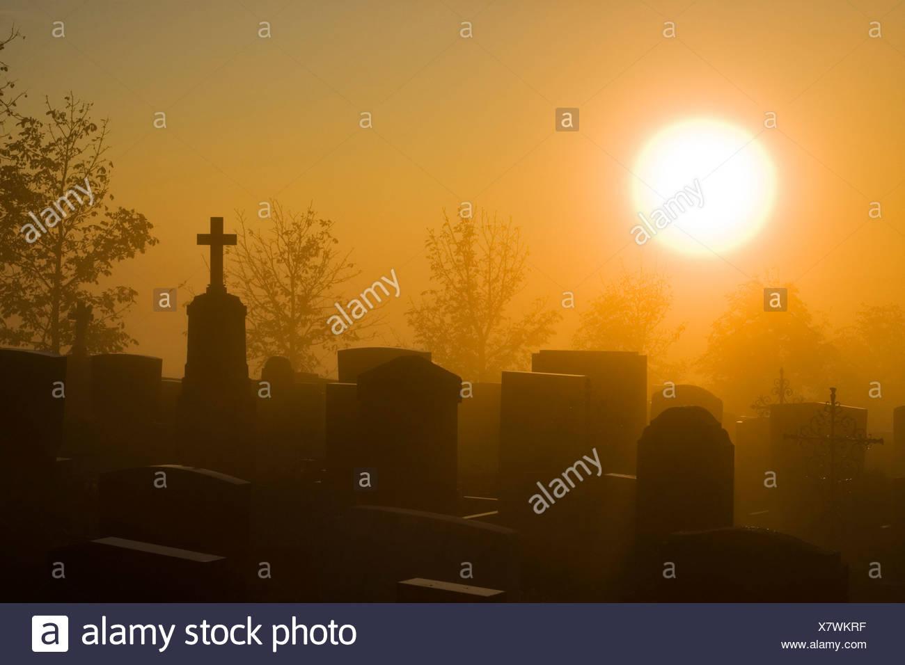 Germany, Bavaria,, Hohenpeißenberg Grave yard at dawn Photo Stock
