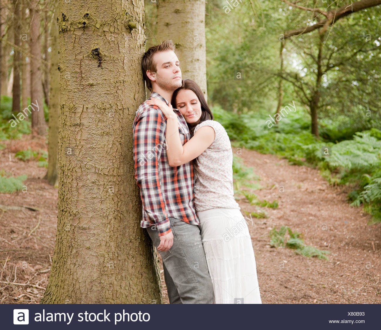 Portrait of young couple in forest Photo Stock