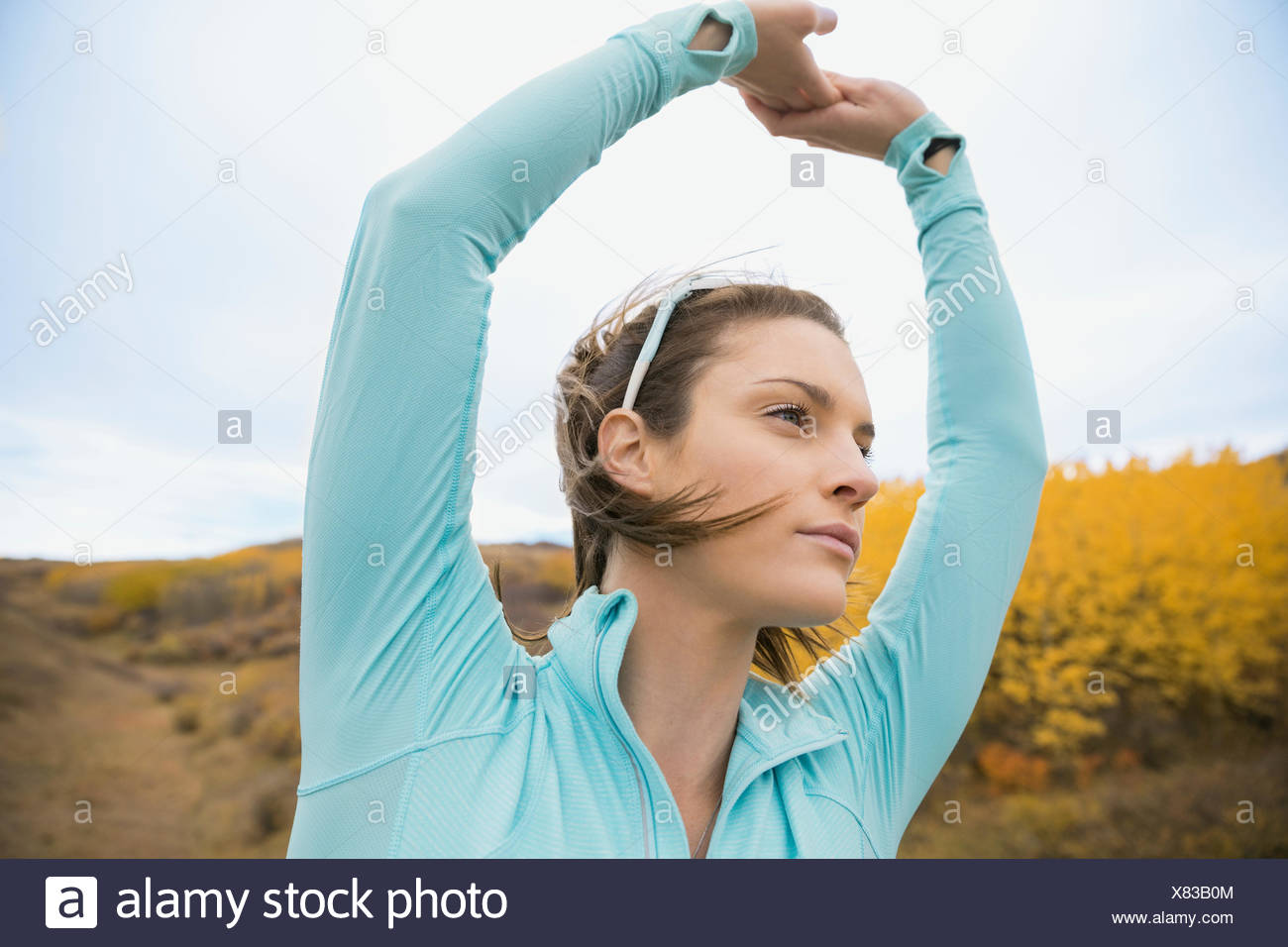 Runner stretching arms Photo Stock