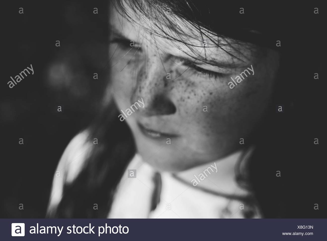 Portrait Of Thoughtful girl looking Away Photo Stock