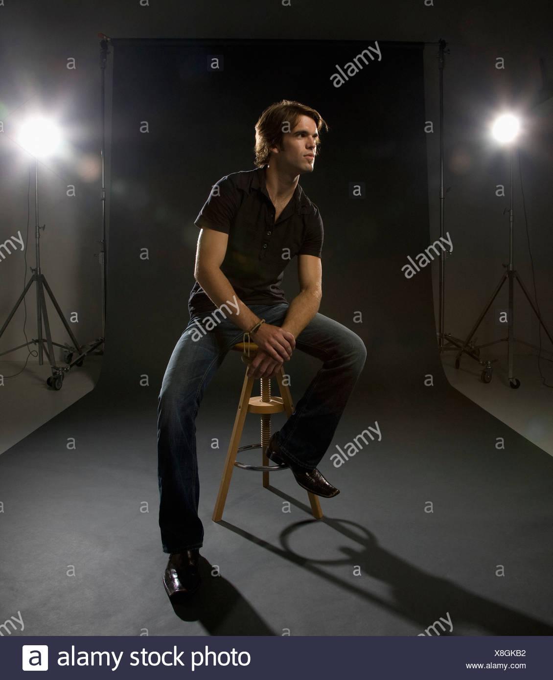 Man posing in studio Photo Stock