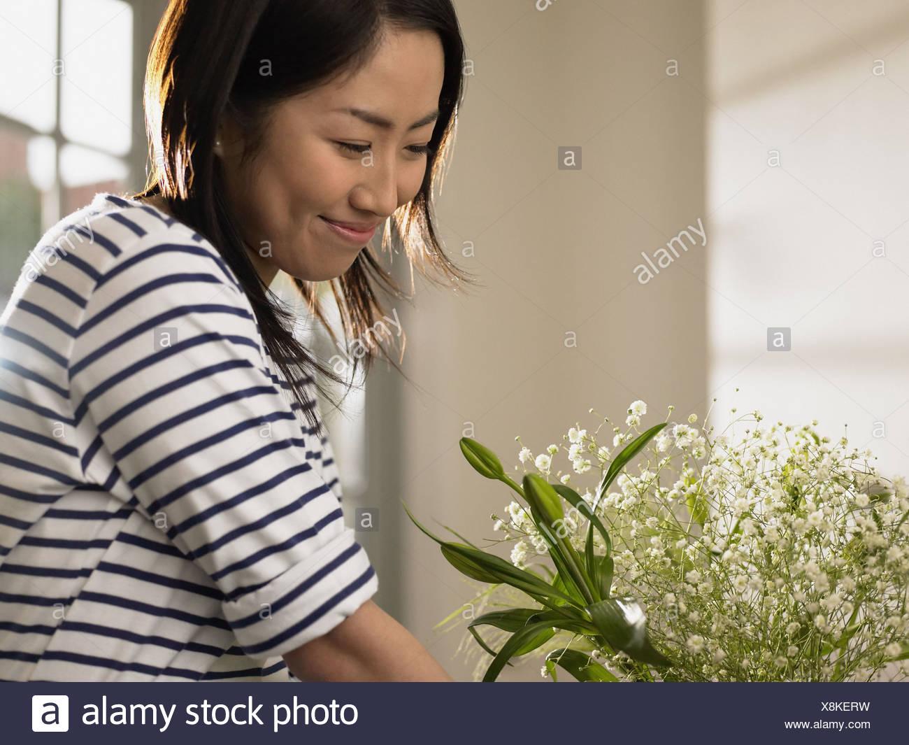 Woman looking at flower arrangement Photo Stock