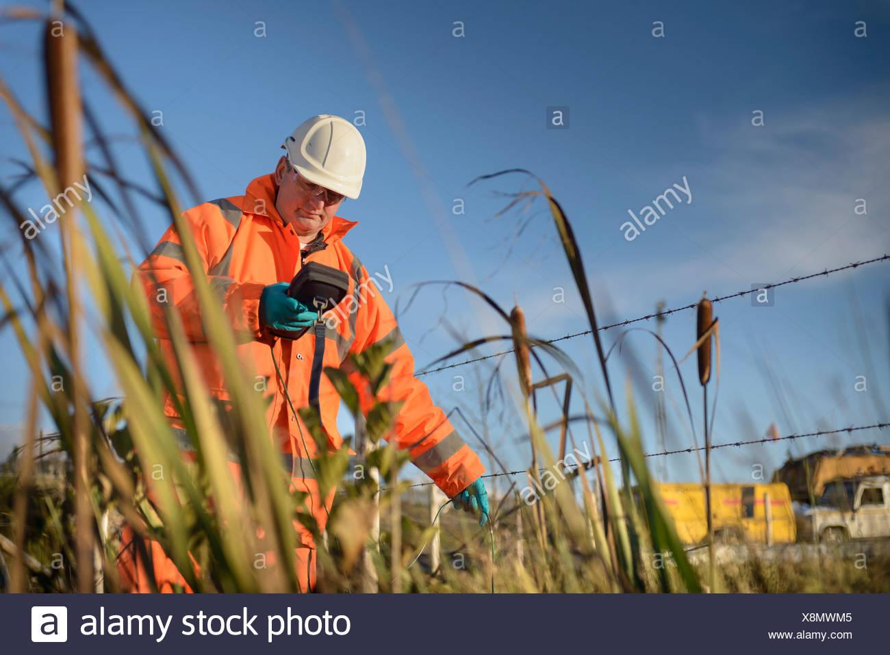 Surveillance des travailleurs des mines de charbon à l'eau Photo Stock