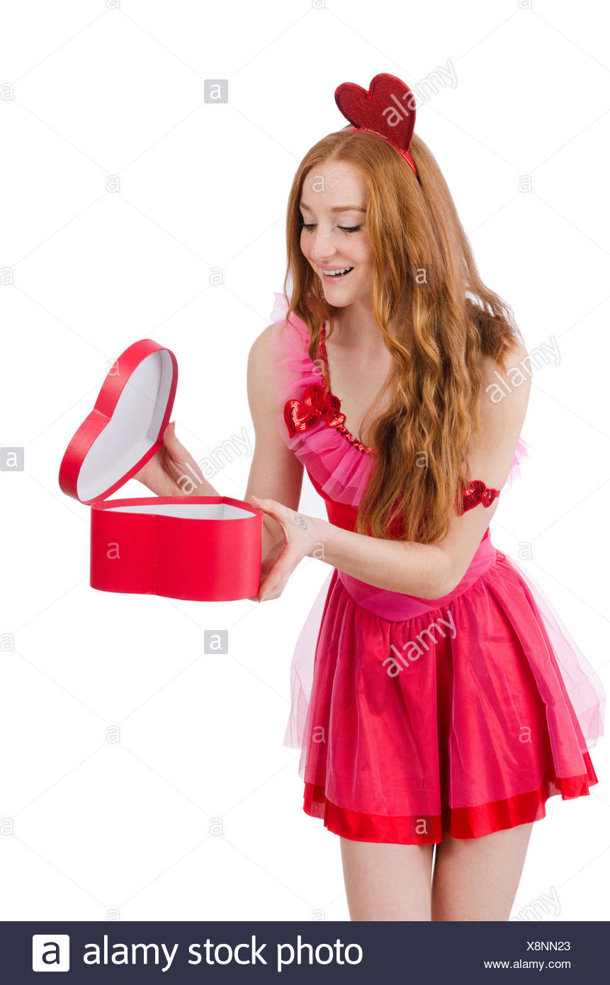Jolie jeune modèle en mini robe rose holding gift box isolated on white c22eb4b4e05