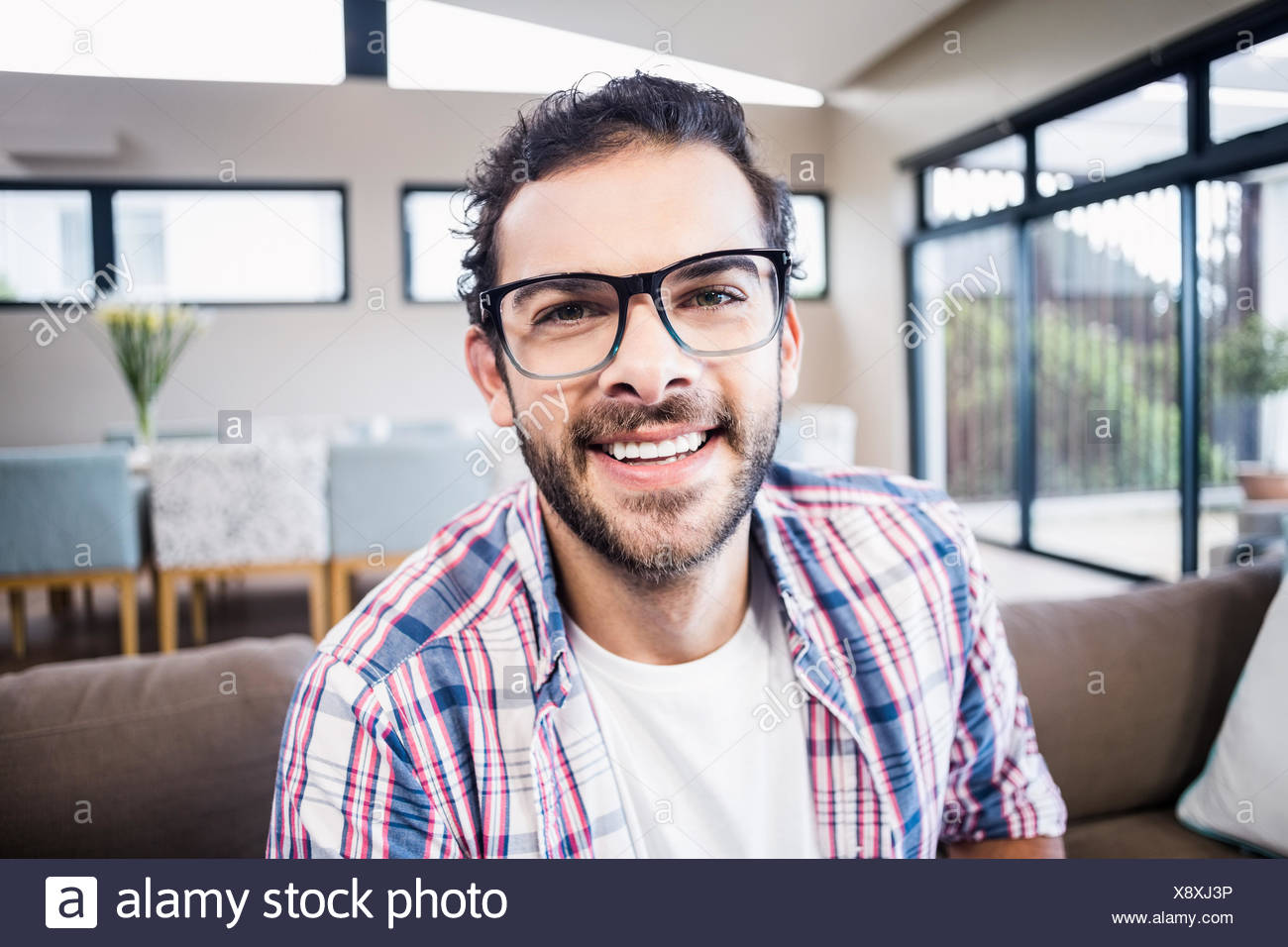 Handsome man smiling at the camera Photo Stock