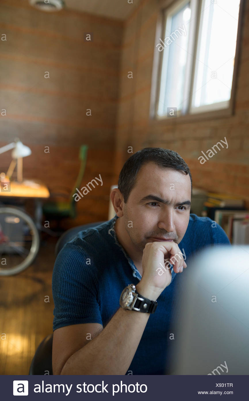 L'accent creative businessman working at computer Photo Stock