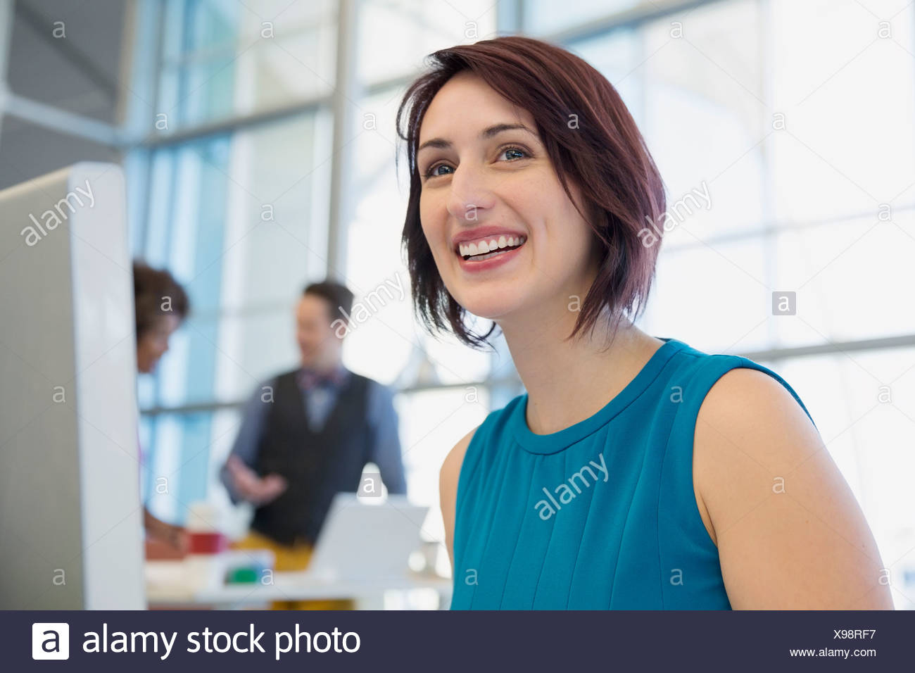 Smiling businesswoman in office Photo Stock