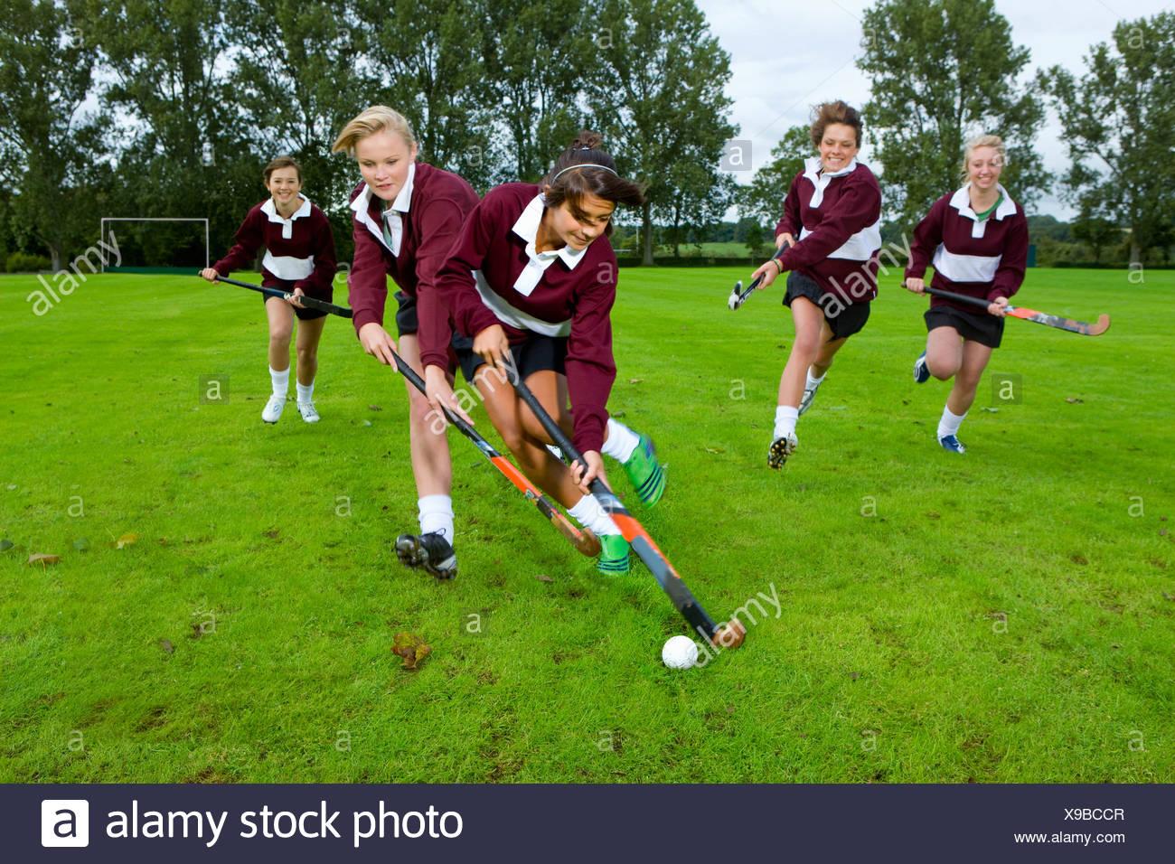 Teenage Girls playing field hockey Photo Stock