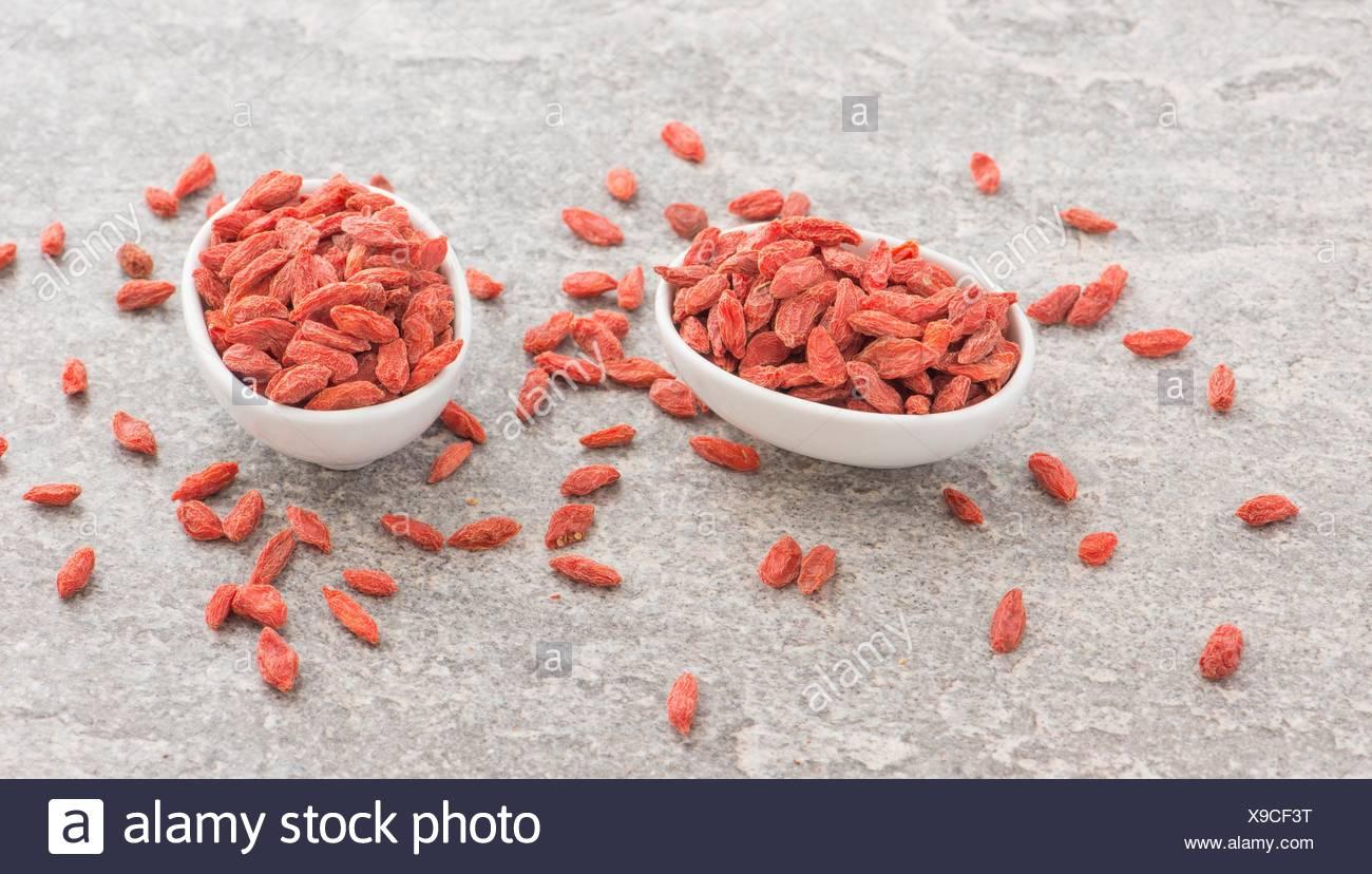 Les baies de goji, fruits rouges séchés. Superfood sain d'Asie avec antioxydant. Une baie remplie de vitamines et de la nutrition. L'alimentation saine, le chinois super fruits Photo Stock