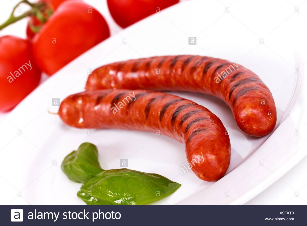 Salade de tomates saucisse Photo Stock