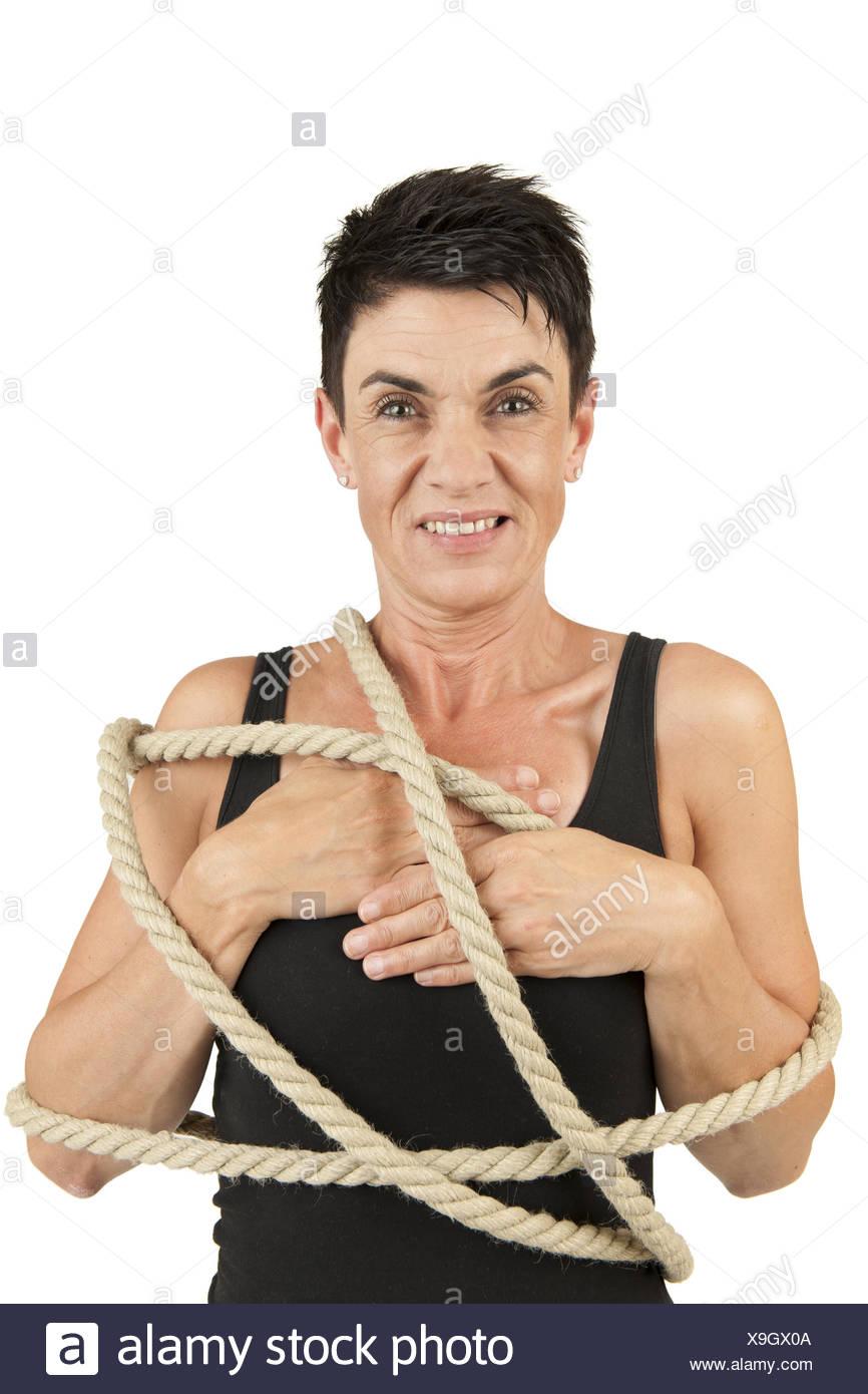 Femme attachée au look plus sinistre Photo Stock