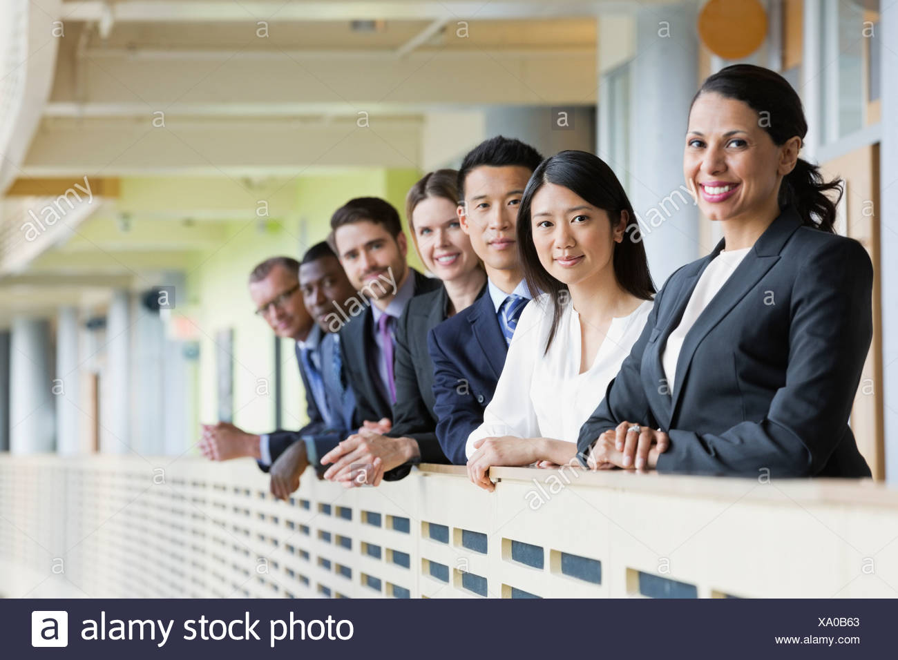 Smiling businesswoman standing in a row Photo Stock