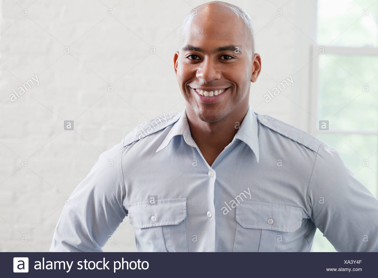 Young office worker smiling, portrait Photo Stock