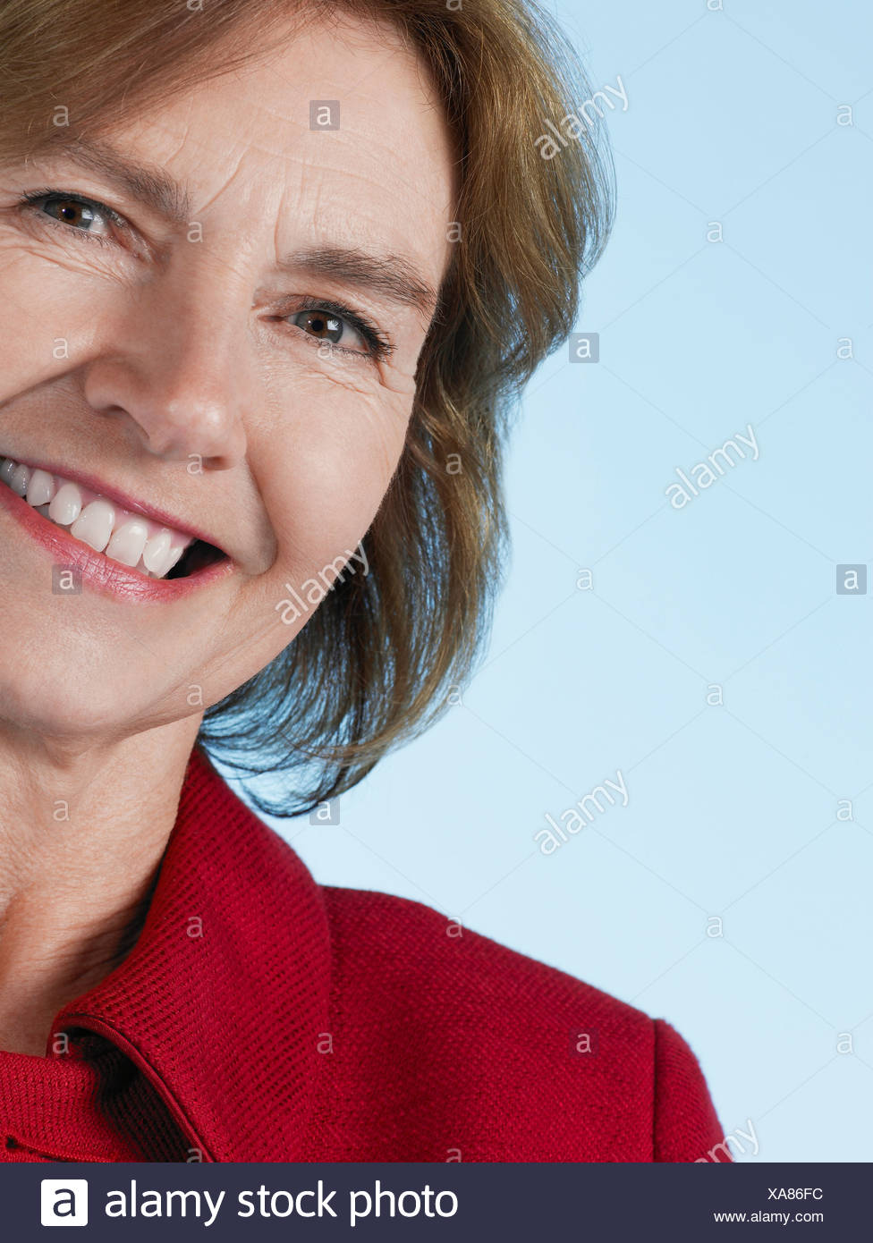 Middle-aged woman smiling, close-up Photo Stock
