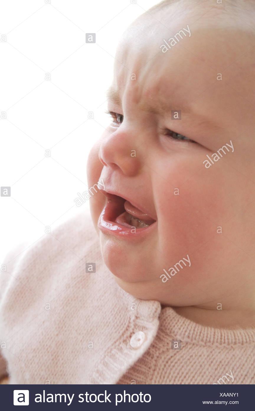 Pleurer, bébé, portrait, enfants, regarder, en larmes, la faim, l'ennui, crier,,, Strampelanzug Strampler softy, doucement, cut out, fille, vue de côté, la moitié de la voie, rose, doucement, studio, Photo Stock