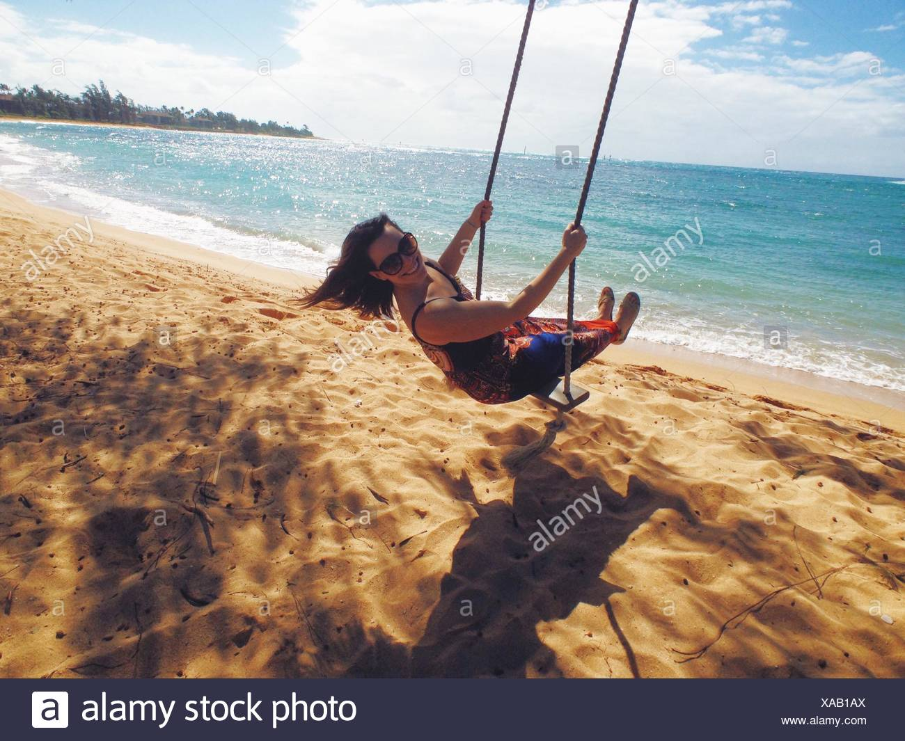 Woman On Beach Swing Photo Stock