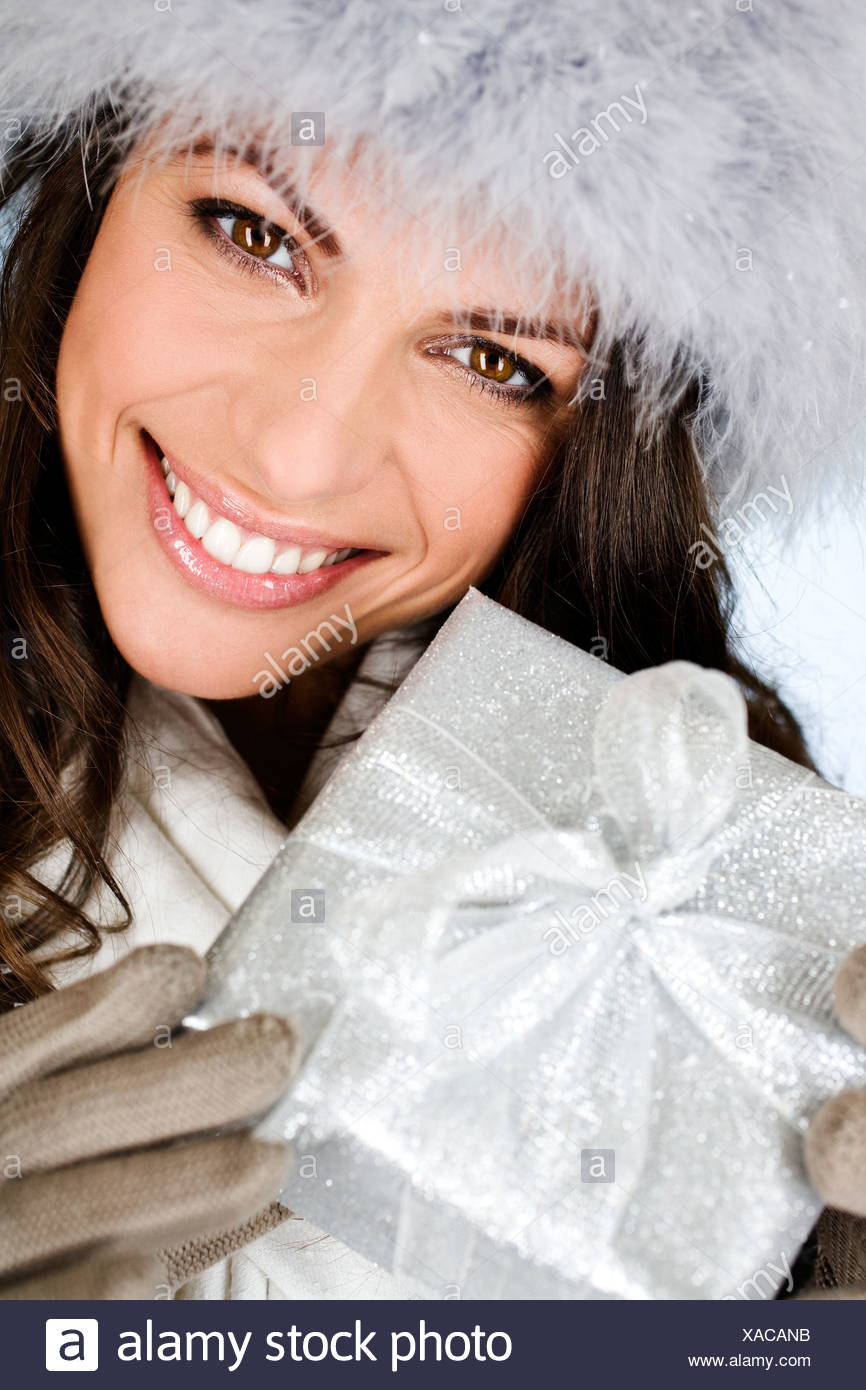 A young woman holding a Christmas present Photo Stock