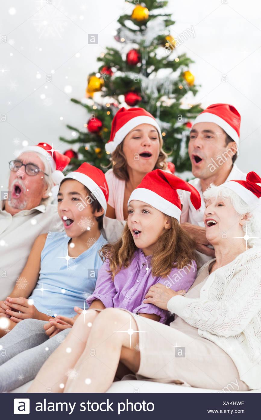 Famille élargie des chants de Noël Photo Stock