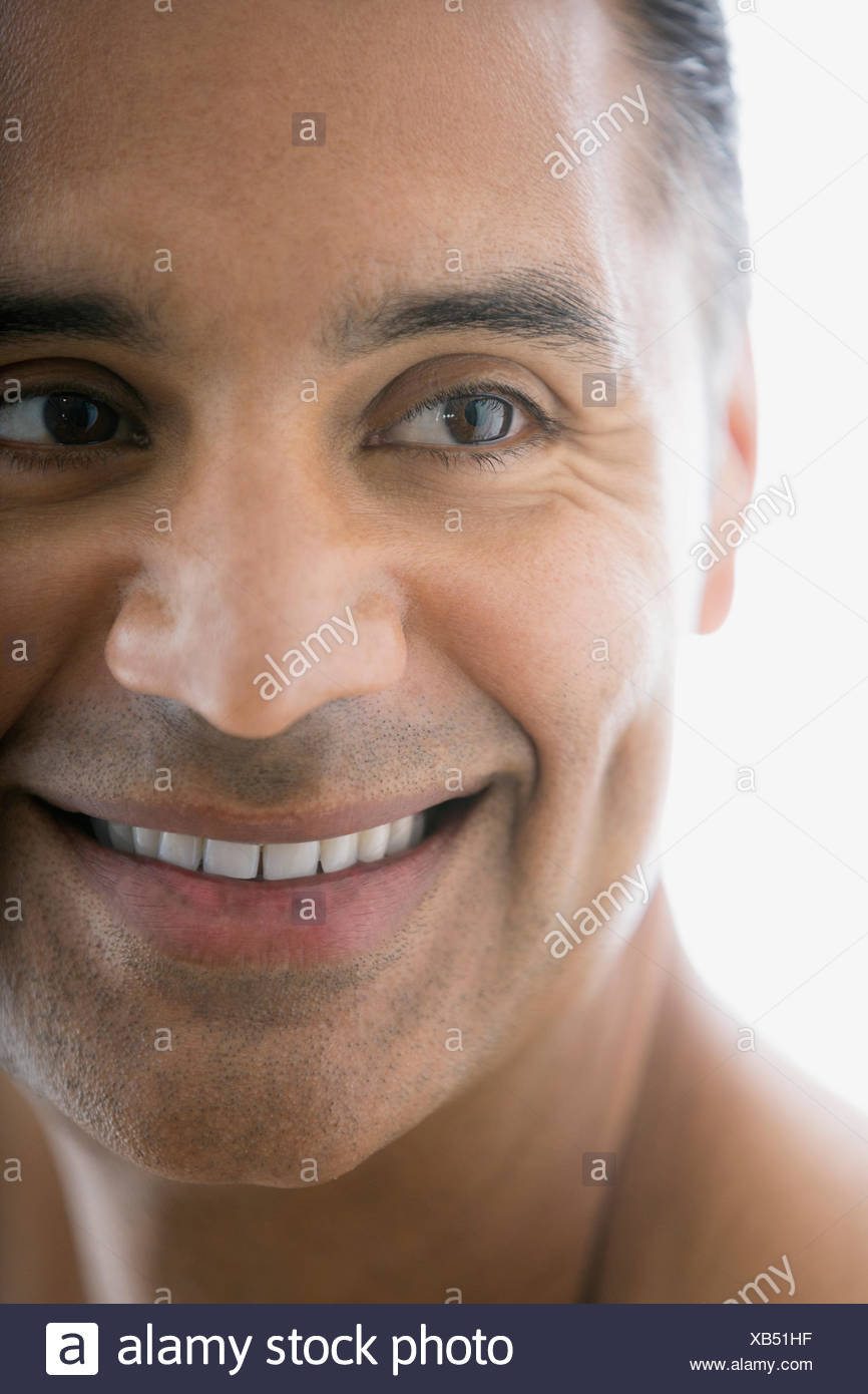 Close up portrait of smiling man looking away Photo Stock